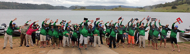 Aussie cricketing legend and keen Freshwater Masters' competitor, Merv Hughes, leads some of the field in his trademark warm-up exercises before the Lake Glenbawn bass round.