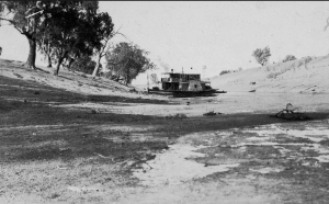 A paddle steamer stranded in the dry bed of the Darling River near Bourke around the end of the 19th century.